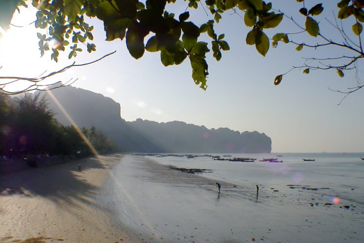 ao nang bay beach sun over cliffs in the morning
