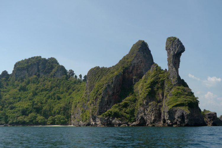 the distinctive limestone rock column on chicken island krabi