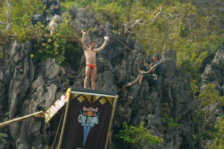 competitor on the cliff diving platform for the red bull competion 2013 at lao lading island krabi