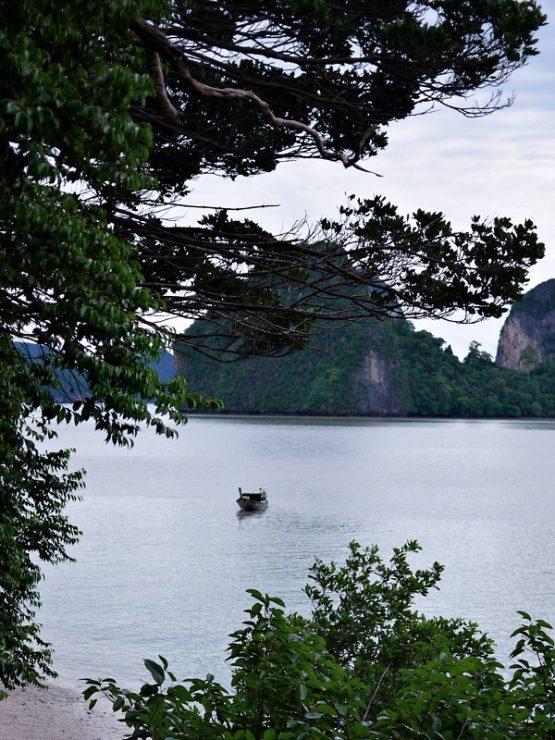 photo of longtail boat near james bond island, phang nga province