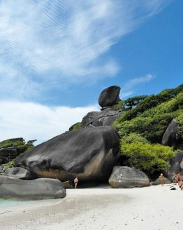 Similan Island visitors on the beach near large rock formation