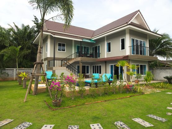 photo- external view of 2 storey villa pool and grounds