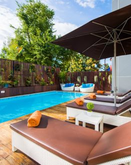 photo of swimming pool, timber desck and sun loungers