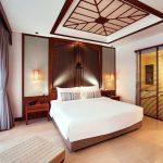 Modern kingsize bed in room with ensuite bathroom