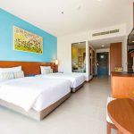 Photo of twin beds in modern resort room
