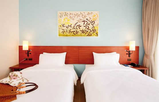 Photo of twin beds in resort room