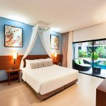 picture of modern hotel room king size bed and glass doors to private pool access