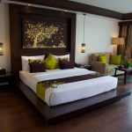 photo of king size bed and thai style furnishing in resort accommodation room