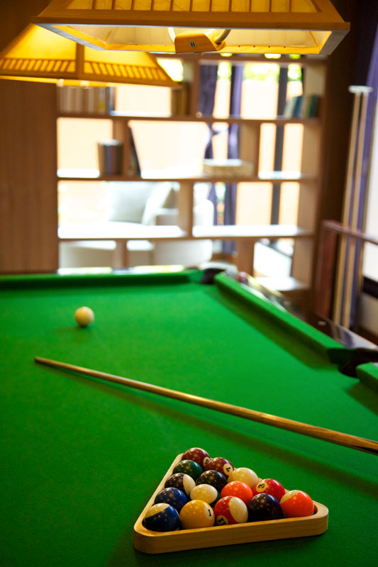 Picture of pool table, balls and cue at resort activity centre
