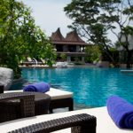 image of pool side villa with furniture towels