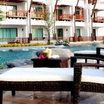 Photo of poolside furniture at resort