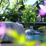 Photo of Thai style villa by resort swimming pool