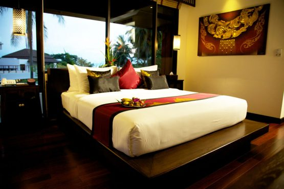 photo of king size bed in resort villa room