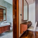 photo of dressing room and en-suite bathroom in contemporary Thai style villa
