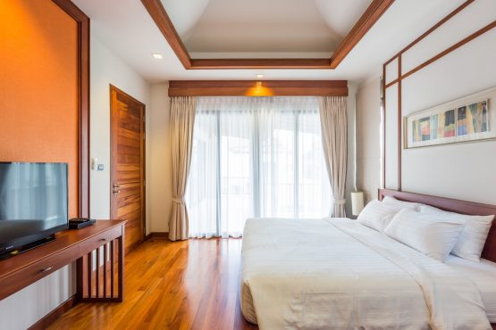 photo of holiday villa bedroom, king bed and large TV