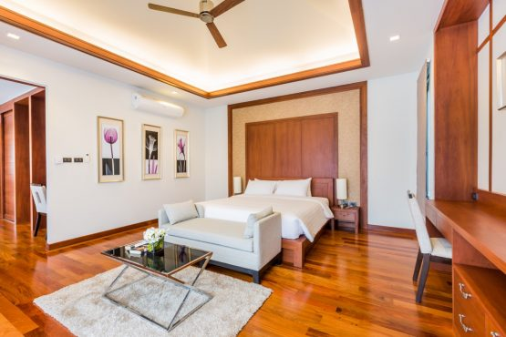 photo of modern holiday villa bedroom with built-in furniture, lounge and coffee table