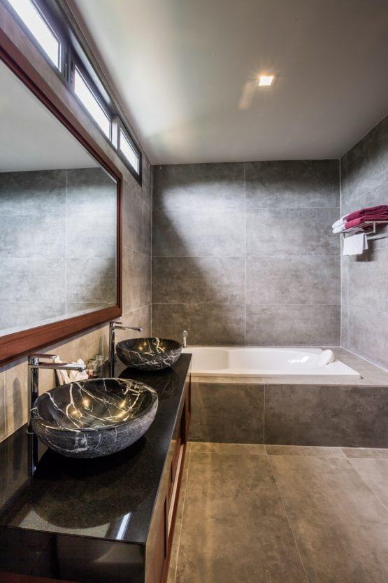 photo of modern bathroom with bath and twin handbasins in Thailand hoilday villa