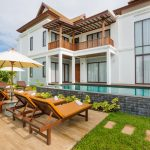photo of external villa - garden area with sun lounger furniture and swimming pool