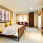 photo of bedroom with king sixe bed, TV and air conditioning in luxury holiday villa in Thailand