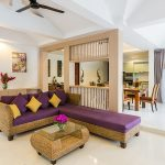 photo of living area lounge and dining furniture with thai style decoration in holiday villa