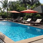 photo of garden swimming pool and deck with outdoor furniture at holiday villa thailand
