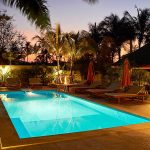 photo of villa swimming pool and garden with outdoor lighting in krabi