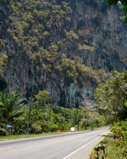 photo of road at base of limestone karst cliff in Krabi province Thailand