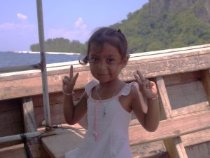 young thai giral on a longtail boat
